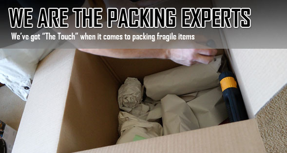 "Person packing a box with the text, ""We are the packing experts. We've got ""the touch"" when it comes to packing fragile items."""